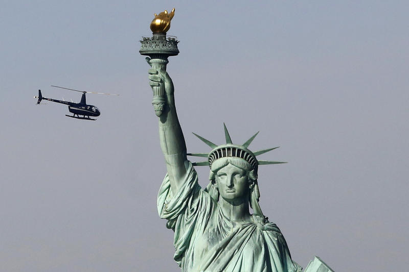 Despite shutdown, troops get football, Lady Liberty to open