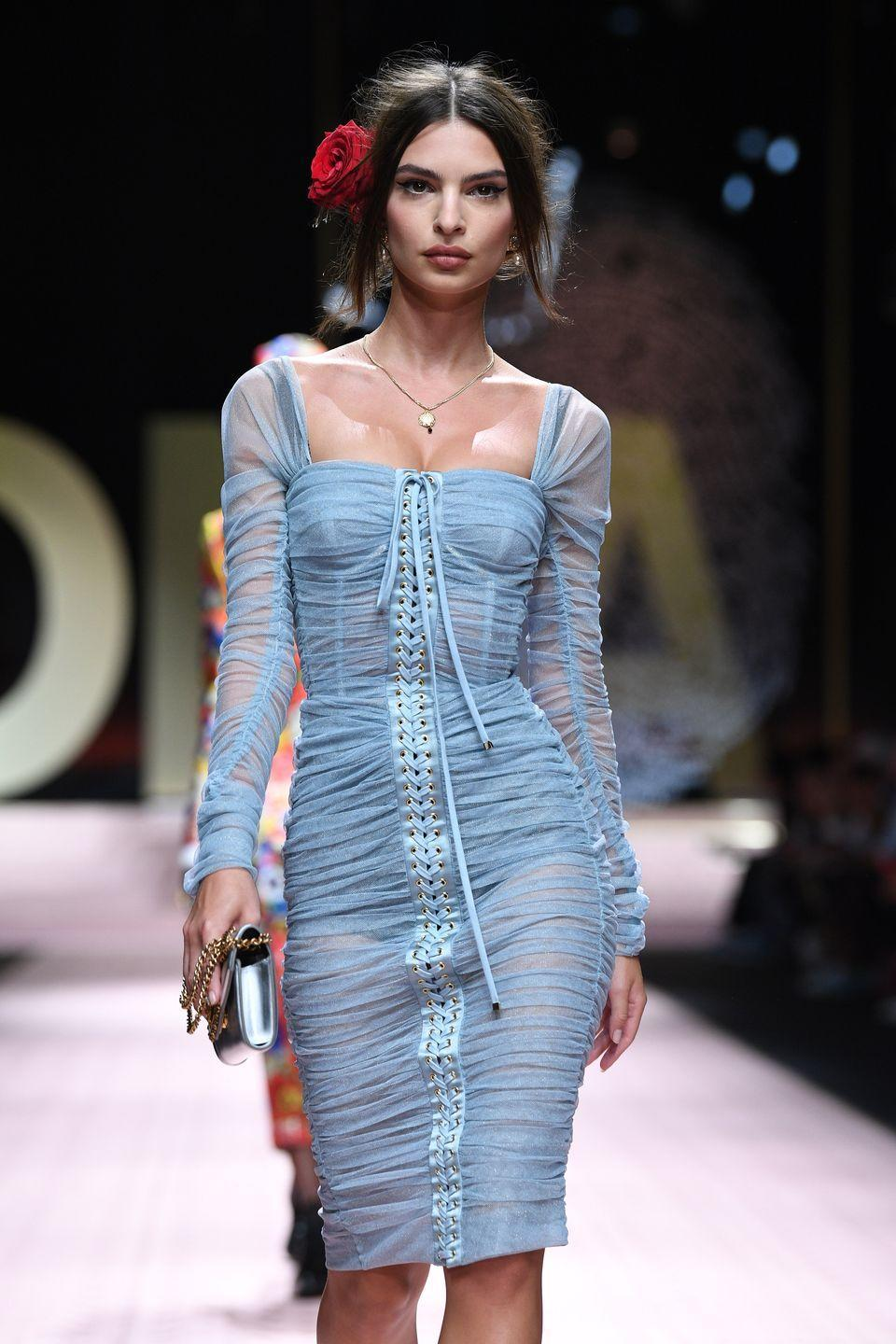 "<p>EmRata's dream of acting and modeling came true when she signed with <a href=""https://www.fordmodels.com/"" rel=""nofollow noopener"" target=""_blank"" data-ylk=""slk:Ford Models"" class=""link rapid-noclick-resp"">Ford Models</a> at age 14. Between small modeling jobs, she dipped her toes into the acting world and once appeared on Nickelodeon show <em>iCarly, </em>according to <a href=""https://www.nytimes.com/2013/10/24/fashion/for-emily-ratajkowski-robin-thickes-blurred-lines-video-brings-a-career-path-into-focus.html"" rel=""nofollow noopener"" target=""_blank"" data-ylk=""slk:The New York Times"" class=""link rapid-noclick-resp""><em>The New York Times</em></a>. She dropped out of college after one year to pursue her modeling career and got her big break in 2011 when she appeared naked in Robin Thicke's music video for ""Blurred Lines.""</p><p>Today, Ratajkowski has appeared in hundreds of magazines and even landed key roles in movies such as <em>Gone Girl, </em><em>Entourage, </em>and <em>I Feel Pretty. </em></p>"