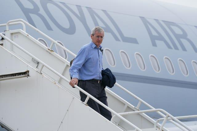 Ambassador to Afghanistan Sir Laurie Bristow exits a plane upon its arrival at RAF Brize Norton base in Oxfordshire after being evacuated from Kabul