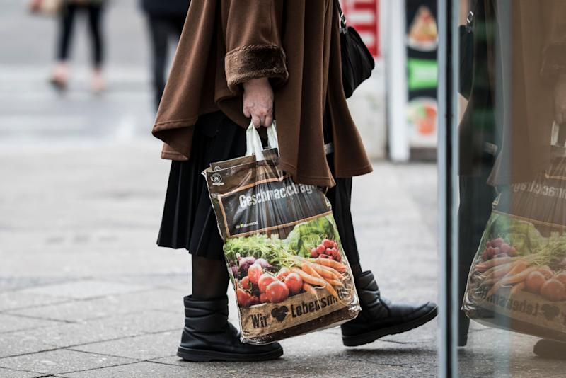 BERLIN, GERMANY - DECEMBER 17: An old woman with a bag of Edeka is pictured on December 17, 2019 in Berlin, Germany. (Photo by Florian Gaertner/Photothek via Getty Images)