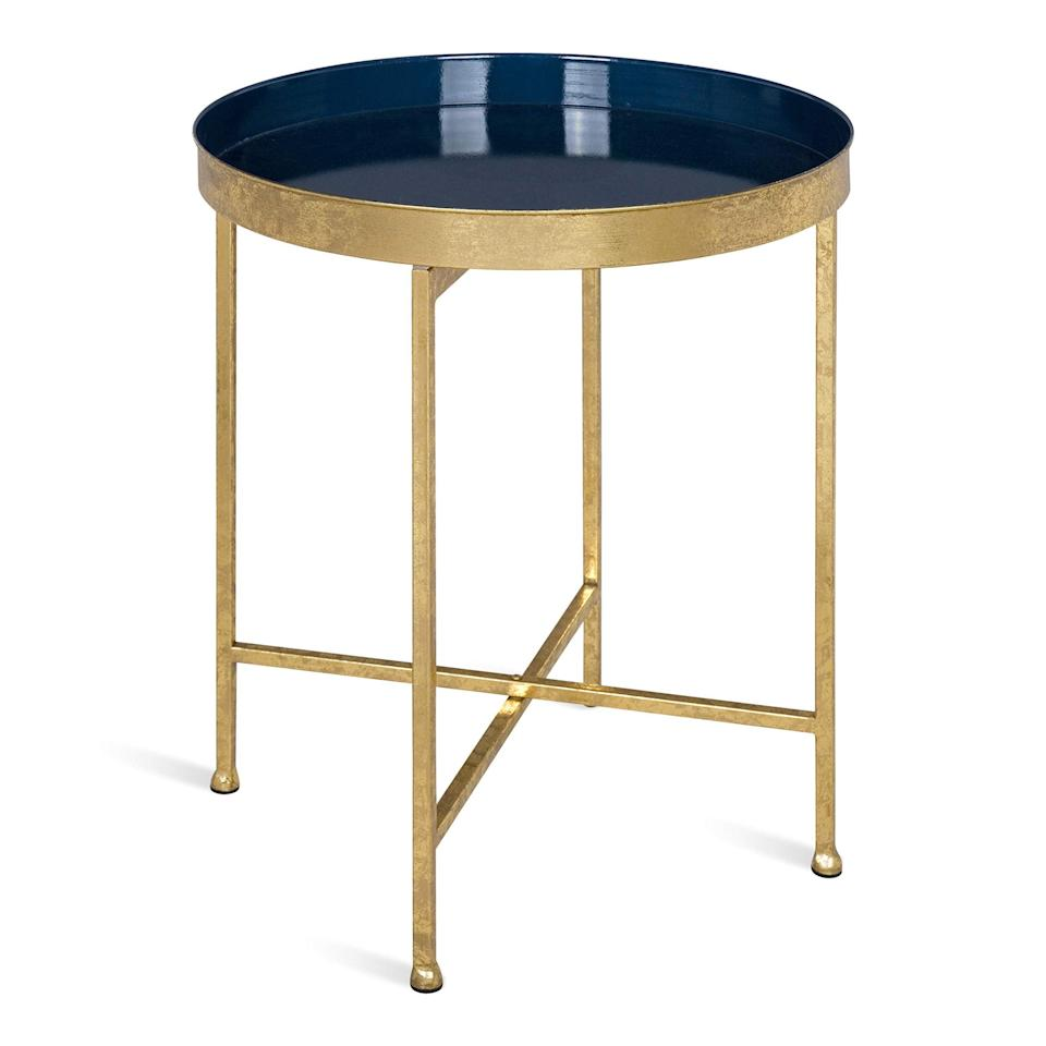 """<h3>Gold Metal Accent Table</h3><br>Let this affordable-yet-elegant, tray-top table act as a golden pedestal for all your favorite trinkets and bedside essentials. <br><br><strong>Kate and Laurel</strong> Celia Metal Foldable Round Accent Table, $, available at <a href=""""https://amzn.to/2MtfAXj"""" rel=""""nofollow noopener"""" target=""""_blank"""" data-ylk=""""slk:Amazon"""" class=""""link rapid-noclick-resp"""">Amazon</a>"""
