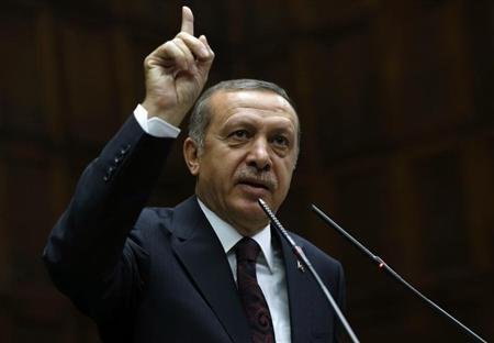 Erdogan addresses members of parliament from his ruling AK Party during a meeting at the Turkish parliament in Ankara