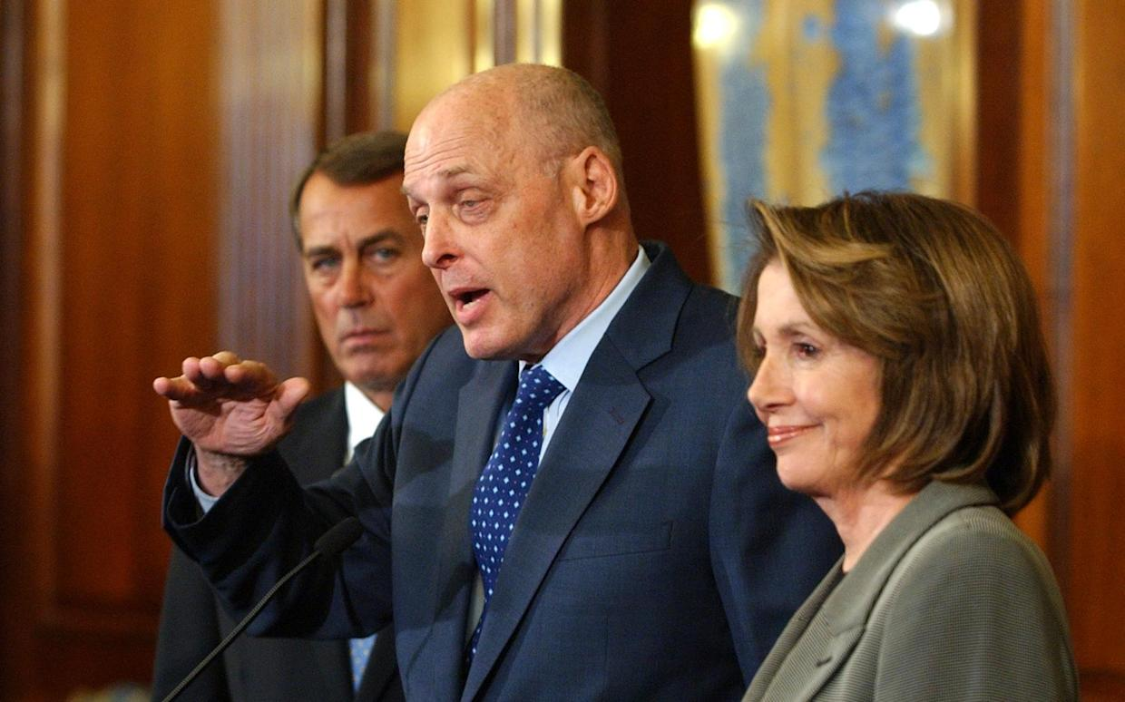 Treasury Secretary Henry Paulson, flanked by the House Minority Leader, Republican John Boehner of Ohio, and the House Speaker, Democrat Nancy Pelosi of California, discusses a bipartisan economic stimulus package on Jan. 24, 2009. (Photo: Dennis Cook/AP)