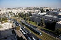 FILE PHOTO: A general view shows Jerusalem's light rail tram as it passes by the old city's walls in Jerusalem November 13, 2014. REUTERS/Ronen Zvulun/File Photo