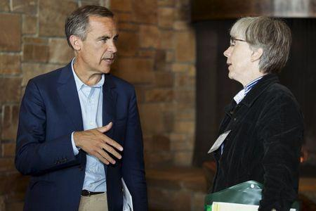 Bank of England Governor Mark Carney (L) talks with U.S. Department of Commerce Chief Economist Susan Helper during the Federal Reserve Bank of Kansas City's annual Jackson Hole Economic Policy Symposium in Jackson Hole, Wyoming, August 29, 2015. REUTERS/Jonathan Crosby