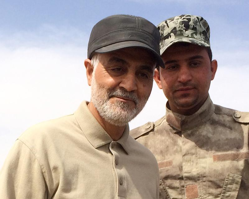 Iranian Revolutionary Guard Commander Qassem Soleimani (L) stands at the frontline during offensive operations against Islamic State militants in the town of Tal Ksaiba in Salahuddin province March 8, 2015. Picture taken March 8, 2015. REUTERS/Stringer (IRAQ - Tags: CIVIL UNREST CONFLICT POLITICS)