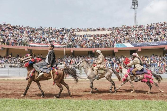 Horsemen rode around the stadium in a show of support for Abiy