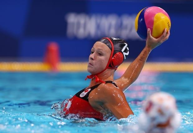 Canada's women's water polo team lost 14-10 to Spain Monday. Winnipeg's Shae la Roche, pictured above, had a pair of goals for Canada in the loss. (Kacper Pempel/Reuters - image credit)