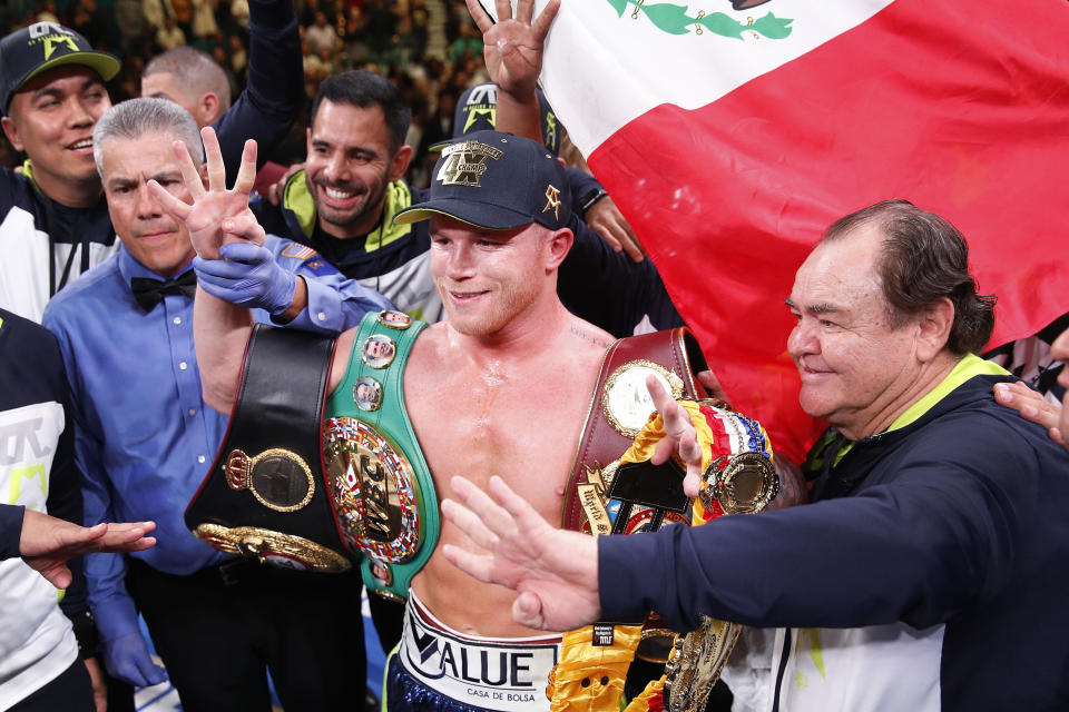 Canelo Alvarez poses for photos after defeating Sergey Kovalev in a light heavyweight WBO title bout, Saturday, Nov. 2, 2019, in Las Vegas (AP Photo/John Locher)