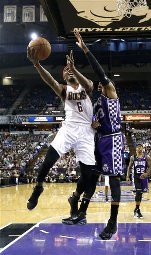 Milwaukee Bucks forward Marquis Daniels, left, drives to the basket against Sacramento Kings guard Marcus Thornton during the first quarter of an NBA basketball game in Sacramento, Calif., Sunday, March 10, 2013.(AP Photo/Rich Pedroncelli)