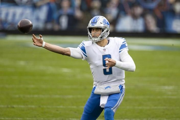 FILE - In this Dec. 20, 2020, file photo, Detroit Lions quarterback Matthew Stafford throws a pass during the second quarter of the team's NFL football game against the Tennessee Titans in Nashville, Tenn. One after another, quarterbacks once believed to be franchise cornerstones after being top five picks changed addresses this offseason in staggering succession. Stafford and Jared Goff switched teams in a swap of former No. 1 overall picks. (AP Photo/Brett Carlsen, File)