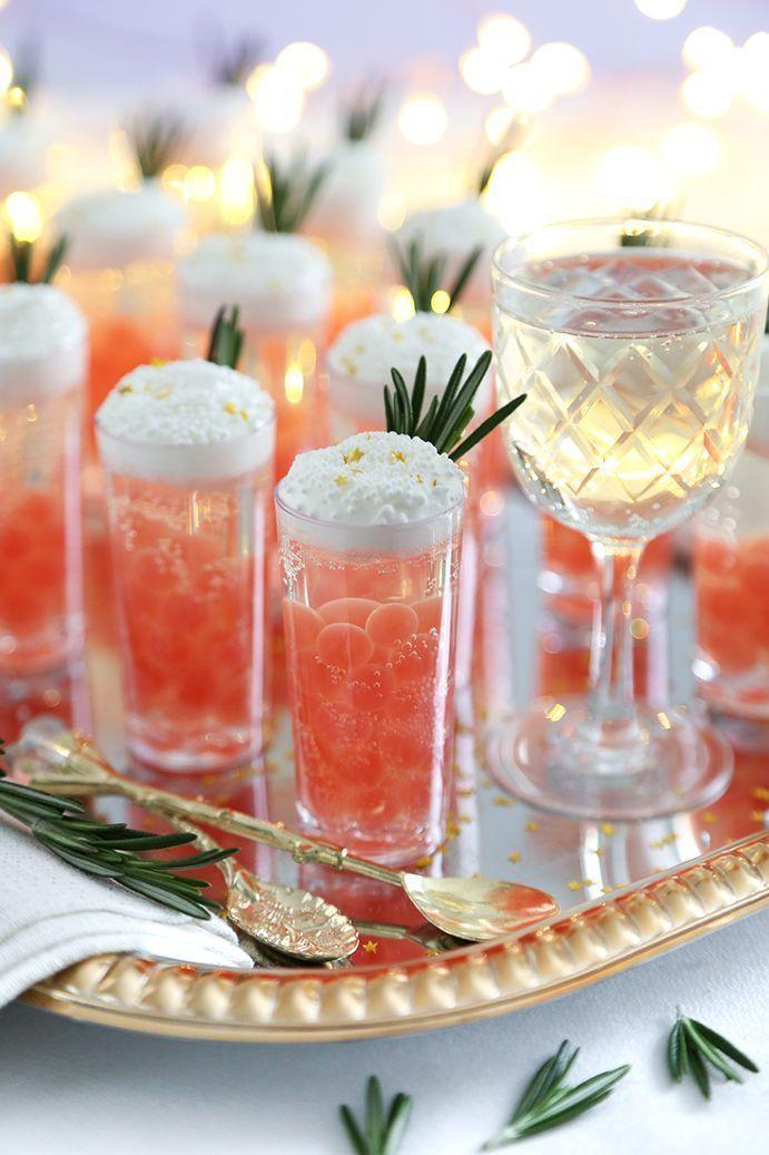 """<p>For a special night cap on Christmas Eve, consider these toast-worthy (and seriously tasty) make-ahead Champagne shooters. </p><p> <em>Get the recipe at <a href=""""https://www.sprinklebakes.com/2019/12/champagne-jelly-shots-with-pomegranate.html"""" rel=""""nofollow noopener"""" target=""""_blank"""" data-ylk=""""slk:Sprinkle Bakes"""" class=""""link rapid-noclick-resp"""">Sprinkle Bakes</a>.</em></p>"""