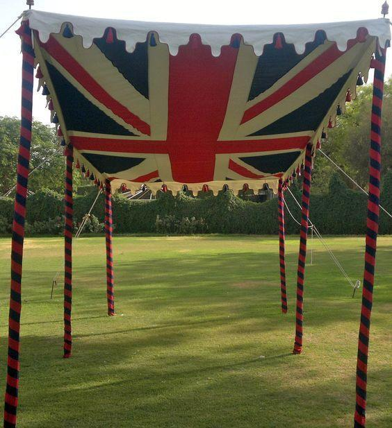 """<p>Whether it's to shield from the sun or rain make your canopy fit for a royal by using a British Flag as decoration. <i><a href=""""https://uk.pinterest.com/pin/AfUi8lXsinm0mOmhj89artfJd3YBl7V7e_rdUdmhQY6Ev1ohLeVNPS8/"""" rel=""""nofollow noopener"""" target=""""_blank"""" data-ylk=""""slk:[Photo: Pinterest]"""" class=""""link rapid-noclick-resp"""">[Photo: Pinterest]</a></i></p>"""