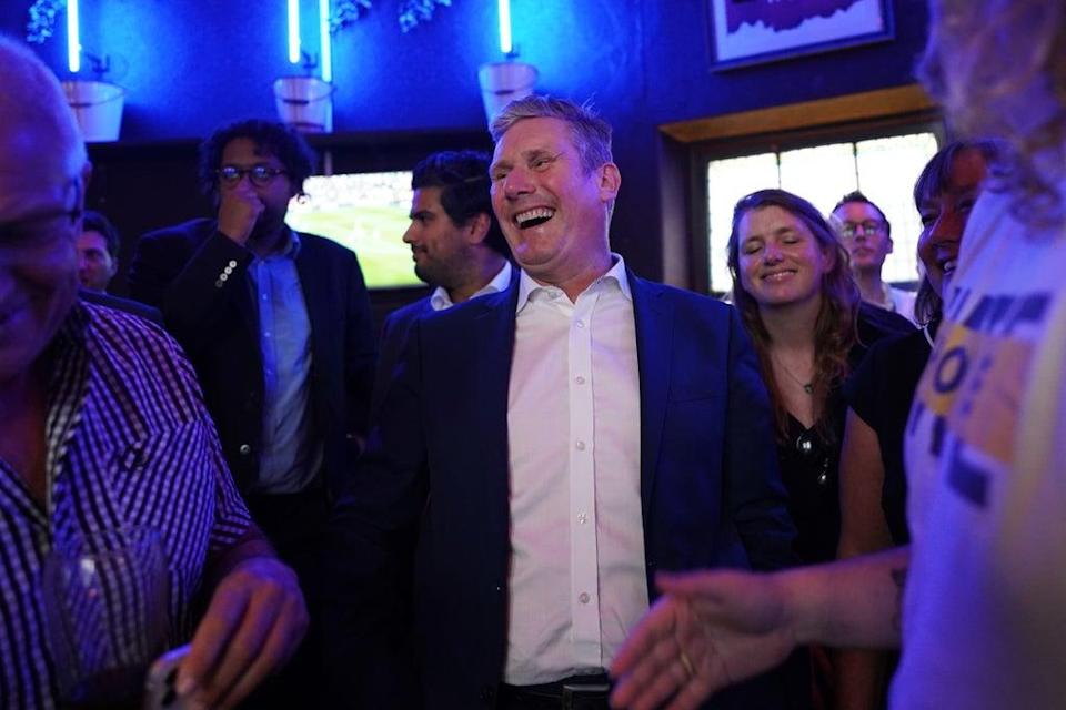 Labour Party leader Sir Keir Starmer speaks to members of the public as he watches the Arsenal v Tottenham Hotspur match at The Font pub in Brighton (PA) (PA Wire)