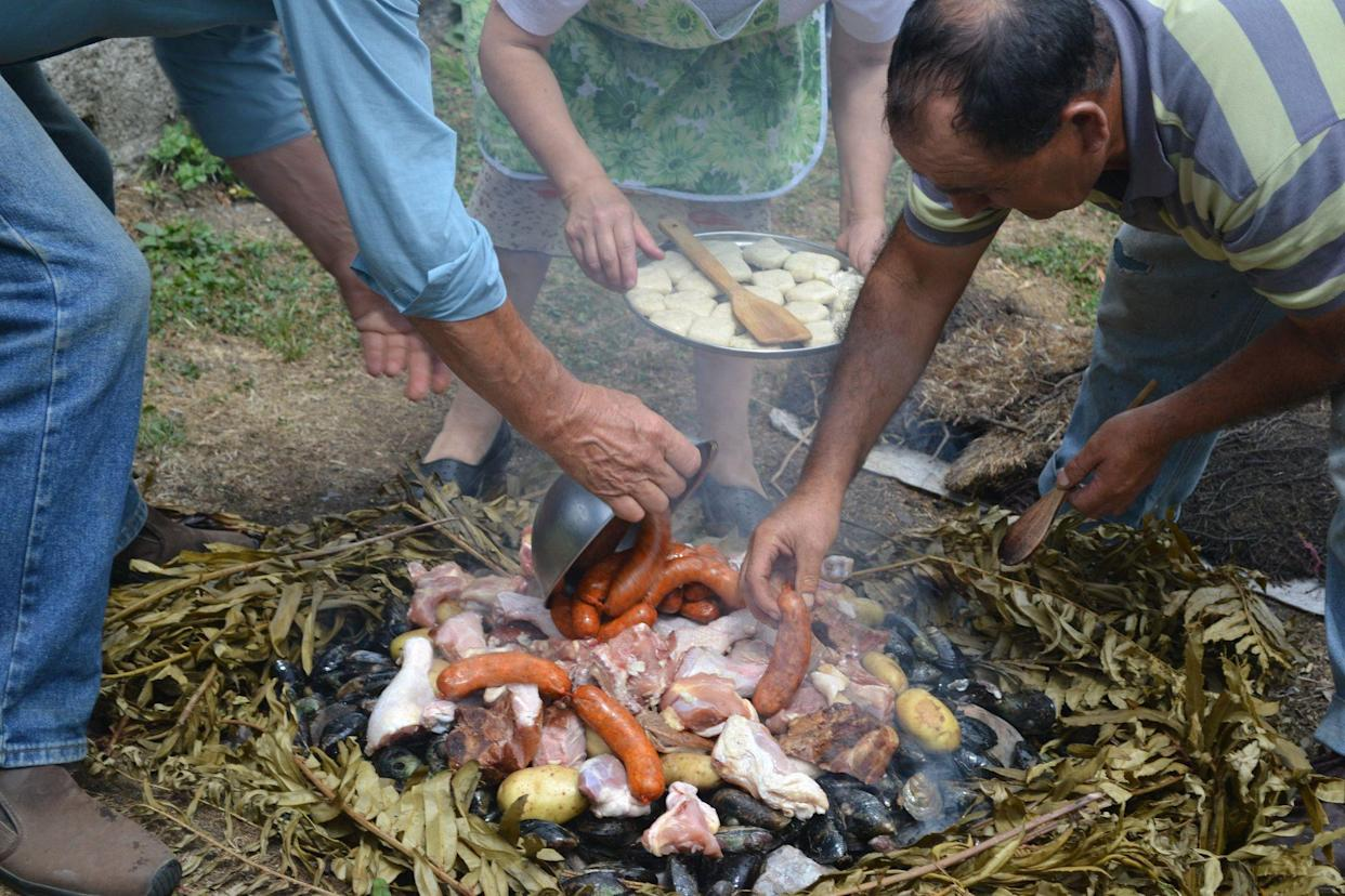 cuanto with meat, seafood, and potatoes