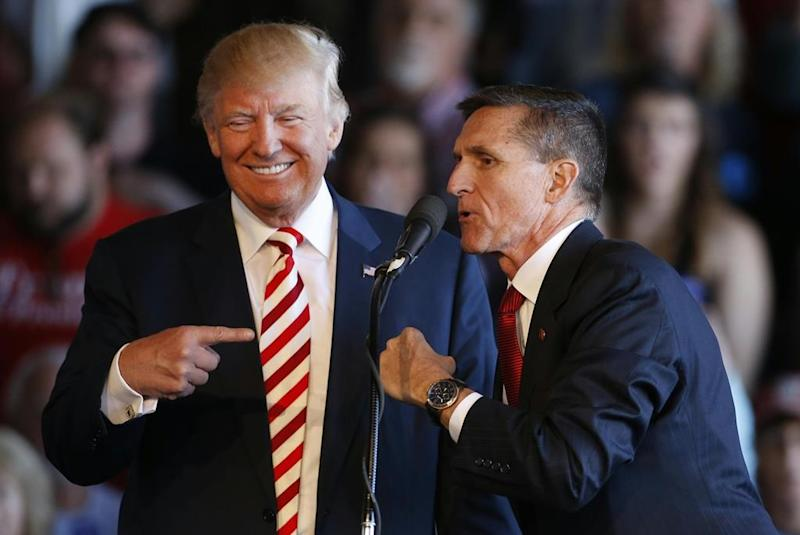 Donald Trump and Michael Flynn speak at a rally in Colorado in October