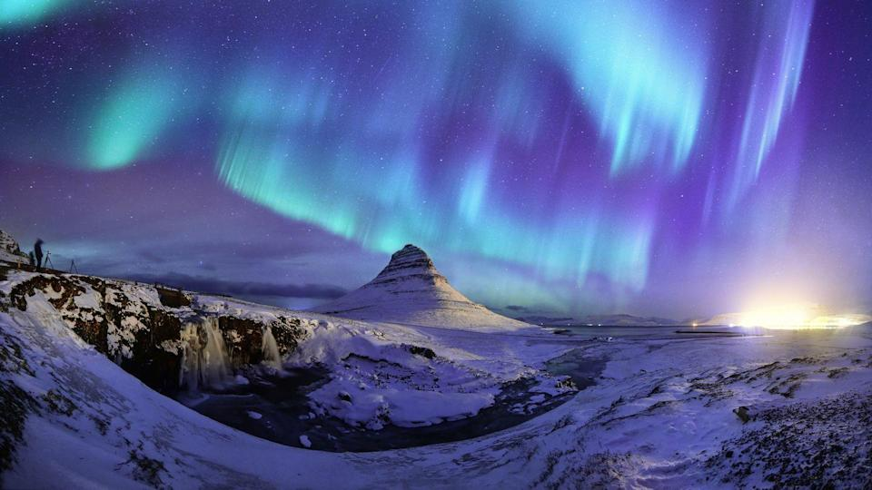 <p>The Aurora Borealis, arguably the most spectacular natural phenomenon, on full display over Mount Kirkjufell in Iceland.</p>