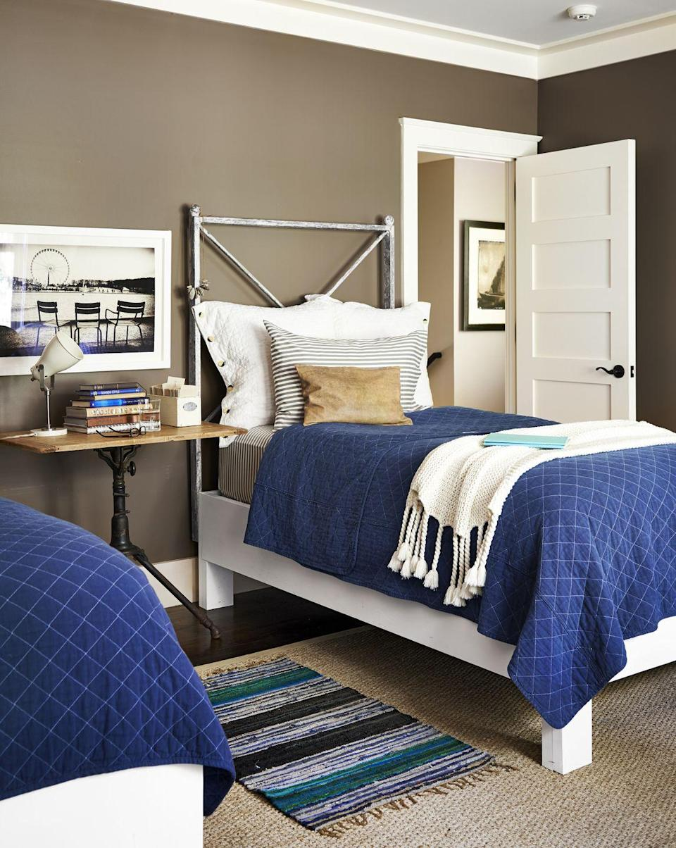 """<p>If you're looking for a neutral that lends a masculine vibe, try a medium brown paint color. The rich neutral delivers warmth without overpowering the room and looks great when paired with white trim, natural wood finishes, and navy or dark green bedding.</p><p><strong>Get the Look:</strong> <br>Wall Paint Color: <a href=""""https://store.benjaminmoore.com/storefront/index.ep"""" rel=""""nofollow noopener"""" target=""""_blank"""" data-ylk=""""slk:Buckhorn by Benjamin Moore"""" class=""""link rapid-noclick-resp"""">Buckhorn by Benjamin Moore</a></p>"""