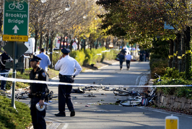 <p>Bicycles and debris lay on a bike path after a motorist drove onto the path near the World Trade Center memorial, striking and killing several people on Oct. 31, 2017. (Photo: Craig Ruttle/AP) </p>