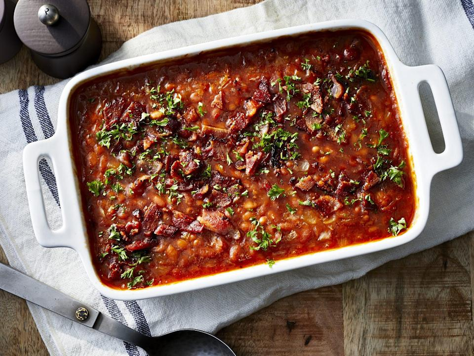 """<p><strong>Recipe:</strong> <a href=""""https://www.southernliving.com/recipes/baked-beans"""" rel=""""nofollow noopener"""" target=""""_blank"""" data-ylk=""""slk:Baked Beans"""" class=""""link rapid-noclick-resp"""">Baked Beans</a></p> <p>No backyard cookout is complete without a side of baked beans. We've even cut down the recipe time so that you can spend less time over the stovetop and more time with guests outdoors. </p>"""