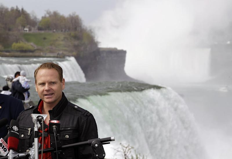 Nik Wallenda speaks during a news conference in Niagara Falls, N.Y., Wednesday, May 2, 2012. Wallenda will try to cross the Niagara Gorge on a tightrope June 15. The seventh-generation member of the Flying Wallendas spent months getting the necessary permissions from Canada and the United States for the cross-border stunt. (AP Photo/David Duprey)