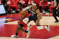 New Orleans Pelicans guard Josh Hart (3) steals the ball from Toronto Raptors forward OG Anunoby during the second half of an NBA basketball game Wednesday, Dec. 23, 2020, in Tampa, Fla. (AP Photo/Chris O'Meara)