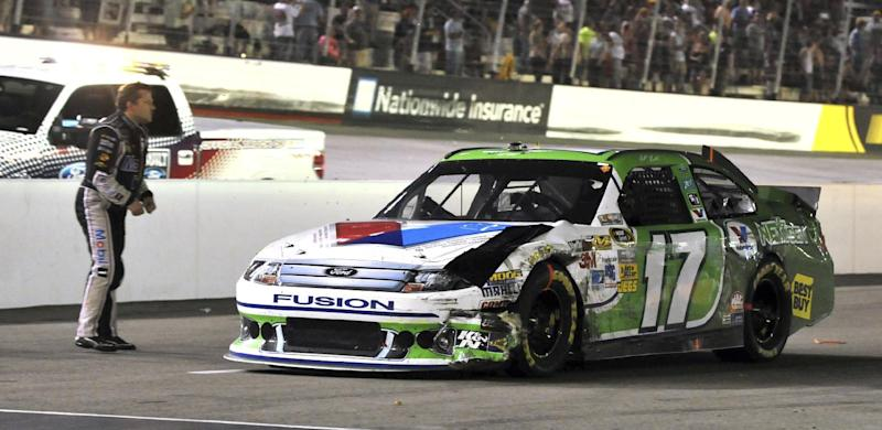 In this Aug. 25, 2012, file photo, NASCAR driver Tony Stewart, left, confronts Matt Kenseth (17) after the two collided during a NASCAR Sprint Cup Series auto race in Bristol, Tenn. Stewart struck and killed a 20-year-old racer who had climbed from his car Saturday, Aug. 9, 2014,  to confront Stewart on a New York dirt track following a crash caused by contact between the two cars