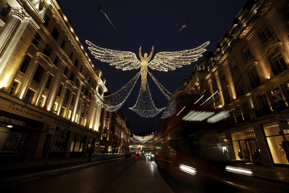 The Regent Street Christmas lights entitled 'The Spirit of Christmas' stand illuminated after being switched on yesterday without a ceremony as shops on the street lie temporarily closed due to England's second coronavirus lockdown, in London, Sunday, Nov. 15, 2020. This week saw Britain on Wednesday become the fifth country in the world to record more than 50,000 coronavirus-related deaths and on Thursday to record 33,470 people testing positive for COVID-19, the highest daily number of new cases since the virus first struck. (AP Photo/Matt Dunham)