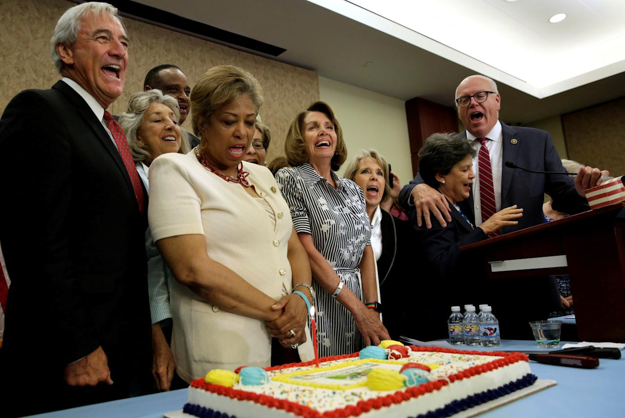 House Minority Leader Nancy Pelosi (D-CA) (C) and House democrats sing 'Happy Birthday' to celebrate the 52nd Anniversary of Medicare and Medicaid on Capitol Hill in Washington, U.S., July 27, 2017. REUTERS/Yuri Gripas     TPX IMAGES OF THE DAY