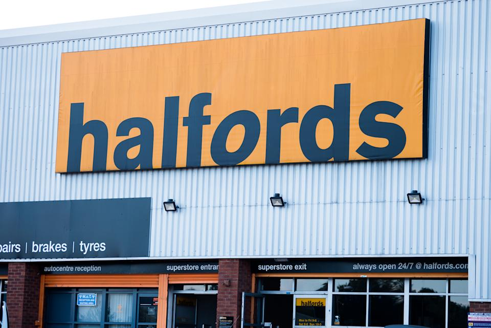 RAYLEIGH, ENGLAND - SEPTEMBER 03: A general view of signage on an Halfords superstore and autocentre on September 3, 2019 in Rayleigh, England. (Photo by John Keebls/Getty Images)