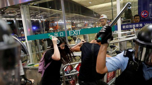 PHOTO: Riot police use pepper spray to disperse protesters during a mass demonstration at the Hong Kong International Airport, in Hong Kong, Aug. 13, 2019. (Tyrone Siu/Reuters)