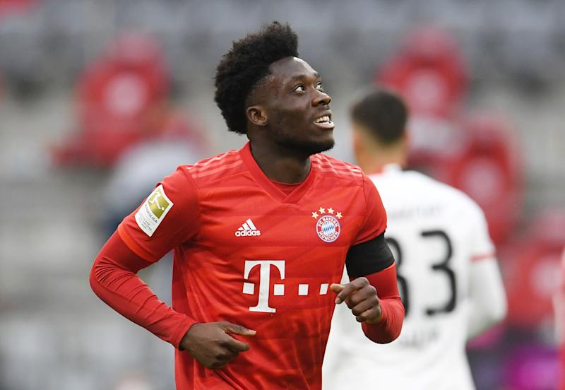 Bayern Munich's Canadian midfielder Alphonso Davies celebrates scoring his team's fourth goal during the German first division Bundesliga football match between FC Bayern Munich and Eintracht Frankfurt on May 23, 2020 in Munich, southern Germany. (Photo by ANDREAS GEBERT / POOL / AFP) / DFL REGULATIONS PROHIBIT ANY USE OF PHOTOGRAPHS AS IMAGE SEQUENCES AND/OR QUASI-VIDEO (Photo by ANDREAS GEBERT/POOL/AFP via Getty Images)