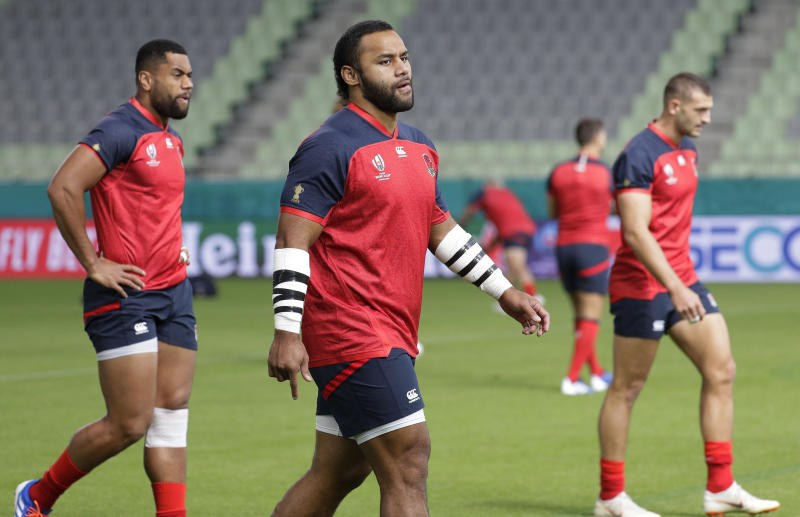 England rugby team player Billy Vunipola, center, walks as they train at the Kobe Misaki Stadium during the Rugby World Cup in Kobe, western Japan on Wednesday Sept. 25, 2019. England will play against USA tomorrow in their Pool C game. (AP Photo/Aaron Favila)