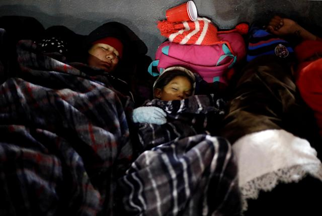 <p>Members of a caravan of migrants from Central America sleep near the San Ysidro checkpoint after a small group of fellow migrants entered the United States border and customs facility, where they are expected to apply for asylum, in Tijuana, Mexico April 29, 2018. (Photo: Edgard Garrido/Reuters) </p>