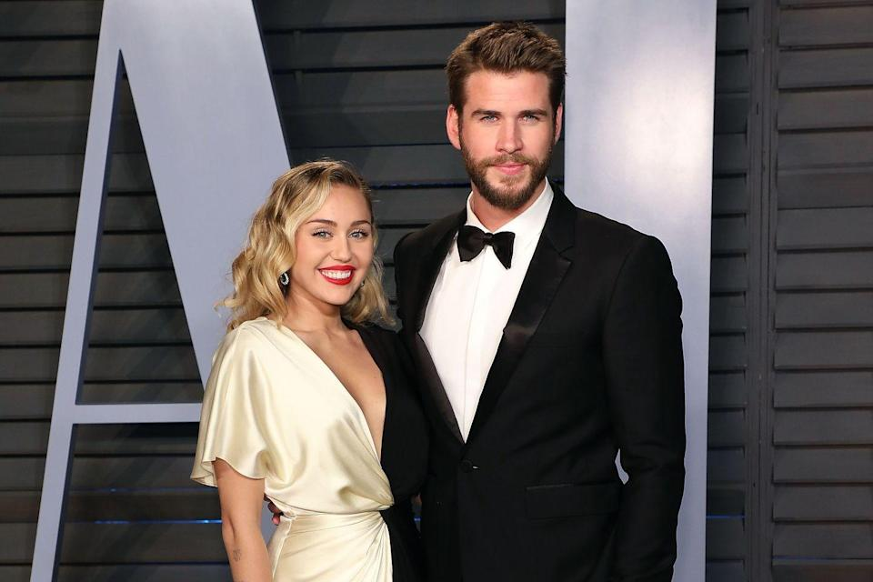 """<p>Miley Cyrus and Liam Hemsworth became an off-screen couple after portraying on-screen love interests in the movie adaptation of Nicholas Sparks' The Last Song. After a short breakup in 2011, the couple announces their <a href=""""https://people.com/celebrity/miley-cyrus-engaged-to-liam-hemsworth-hunger-games-star-proposed-may-31/"""" rel=""""nofollow noopener"""" target=""""_blank"""" data-ylk=""""slk:(first) engagement in 2012"""" class=""""link rapid-noclick-resp"""">(first) engagement in 2012</a>. When Miley and Liam got back together in 2016, she whipped out her old engagement ring, but they didn't wed until <a href=""""https://people.com/style/miley-cyrus-liam-hemsworth-wedding-photos/"""" rel=""""nofollow noopener"""" target=""""_blank"""" data-ylk=""""slk:December 2018"""" class=""""link rapid-noclick-resp"""">December 2018</a>. Less than a year later, <a href=""""https://people.com/music/miley-cyrus-liam-hemsworth-split/"""" rel=""""nofollow noopener"""" target=""""_blank"""" data-ylk=""""slk:the couple split"""" class=""""link rapid-noclick-resp"""">the couple split</a>.</p>"""