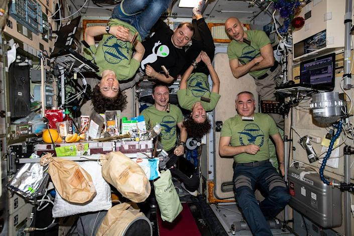 The six member Expedition 61 crew is gathered for a meal
