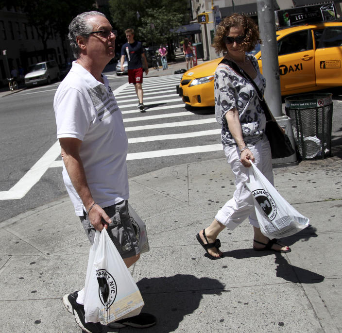 """In this Sunday, July 8, 2012 photo, Jason Marder walks home with his wife, Karin Marder, after visiting a grocery store in New York. Jason Marder, who turned 70 on Tuesday, July 10, 2012, was diagnosed with Alzheimer's more than eight years ago. In the roughly five years that her husband has taken Gammagard, """"there has been decline"""" in his health but it is very minimal and the kind of slowing down you might expect from ordinary aging, she said. """"He travels the subways, he does things that you and I do. And our quality of life together is what's most important."""" (AP Photo/Seth Wenig)"""
