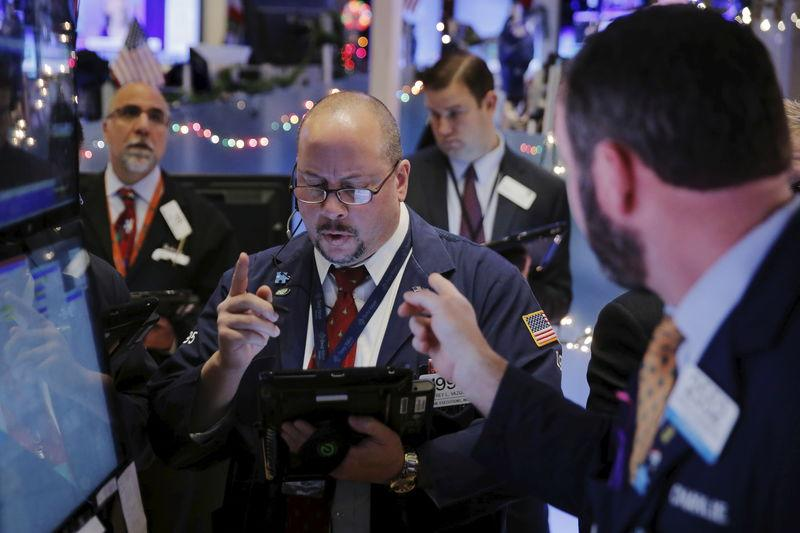 Traders work shortly after the opening bell on the floor of the New York Stock Exchange in the Manhattan borough of New York