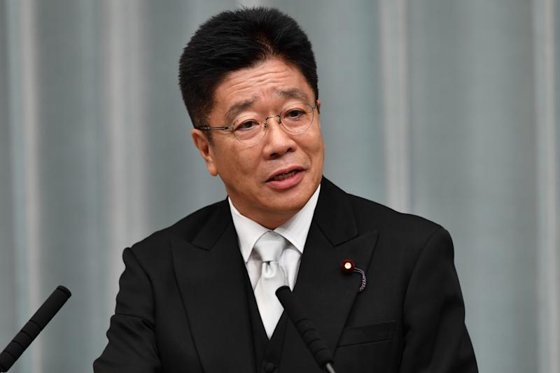 Newly appointed Japanese Health, Labour and Welfare Minister Katsunobu Kato speaks during a press conference at the prime minister's official residence in Tokyo on September 11, 2019. - Japan's Prime Minister Shinzo Abe on September 11 appointed new foreign and defence ministers and promoted a popular rising political star, in a cabinet reshuffle that fuelled speculation over the prime minister's successor. (Photo by Toshifumi KITAMURA / AFP) (Photo credit should read TOSHIFUMI KITAMURA/AFP via Getty Images)