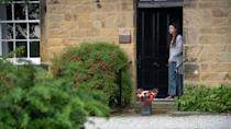 <p>Some flowers appear on her doorstep.</p>