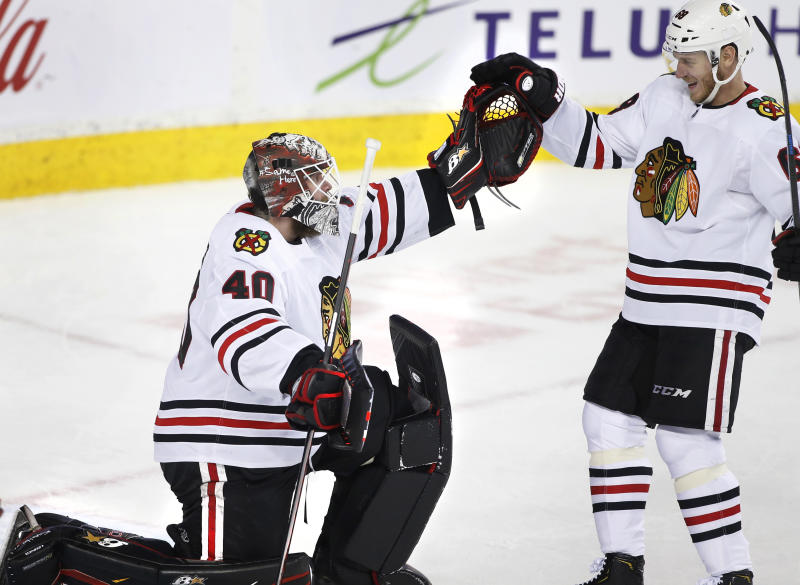 Chicago Blackhawks goalie Robin Lehner, from Sweden, is congratulated by defenseman Slater Koekkoek (68) after the Blackhawks defeated the Calgary Flames in an NHL hockey game Saturday, Feb. 15, 2020, in Calgary, Alberta. (Larry MacDougal/The Canadian Press via AP)