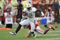 Georgia Tech wide receiver Adonicas Sanders (12) breaks free from Clemson cornerback Sheridan Jones (6) after a catch in the first half of an NCAA college football game, Saturday, Sept. 18, 2021, in Clemson, S.C. (AP Photo/John Bazemore)
