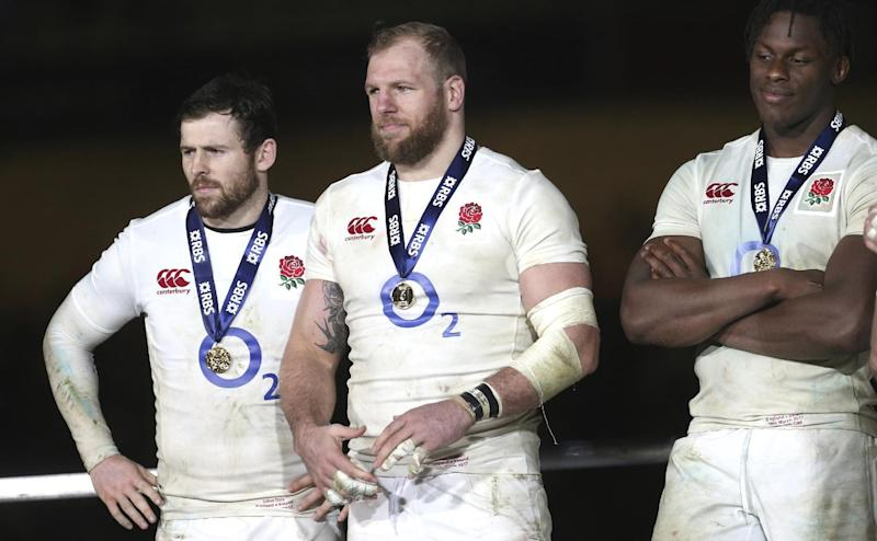 England's James Haskell, centre, with teammates during the trophy presentation after their Six Nations rugby union international match between Ireland and England at the Aviva stadium in Dublin, Ireland, Saturday, March 18, 2017. England win the Six Nations Championship, though they lost the final game 13-9 to Ireland. (AP Photo/Peter Morrison)