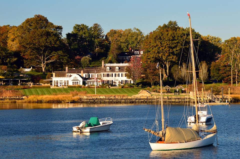 Greenwich, CT, USA October 27, 2013 Sailboats are moored in Indian Harbor in front of an estate in Greenwich Connecticut