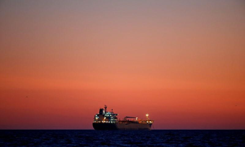 Oil traders book more tankers for sea storage as global crude glut builds - sources