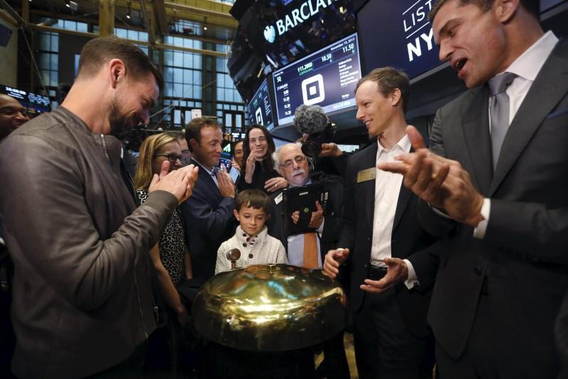 Dorsey, McKelvey and Farley watch as Mac Riley rings a ceremonial opening bell on the floor of the New York Stock Exchange for the IPO of Square Inc., in New York