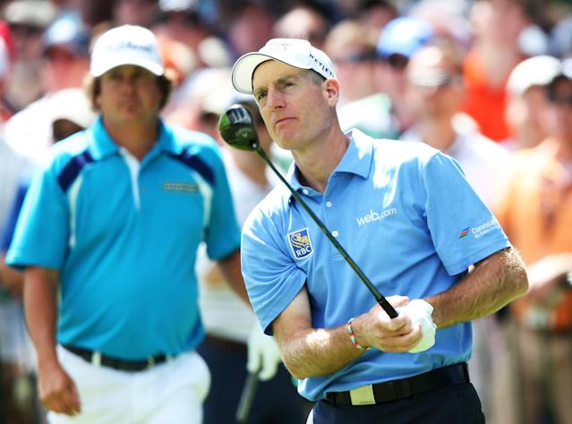 ROCHESTER, NY - AUGUST 11: Jim Furyk of the United States watches his tee shot on the first hole as Jason Dufner of the United States looks on during the final round of the 95th PGA Championship on August 11, 2013 in Rochester, New York. (Photo by Andrew Redington/Getty Images)