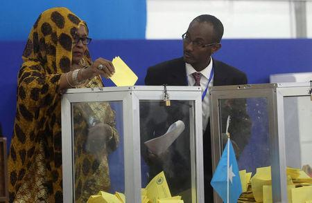 A Somali lawmaker casts her ballot during the presidential vote at the airport in Somalia's capital Mogadishu, February 8, 2017. REUTERS/Feisal Omar