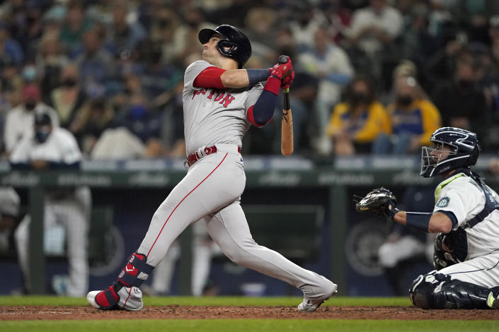 Boston Red Sox's Jose Iglesias hits an RBI single to score Alex Verdugo during the fifth inning of a baseball game against the Seattle Mariners, Monday, Sept. 13, 2021, in Seattle. (AP Photo/Ted S. Warren)