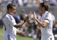 Real Madrid's Gareth Bale, right, celebrates after scoring a goal against Inter Milan with Raul De Tomas during the first half of a soccer match in the first round of the Guinness International Champions Cup, Saturday, July 26, 2014, in Berkeley, Calif. (AP Photo/Ben Margot)